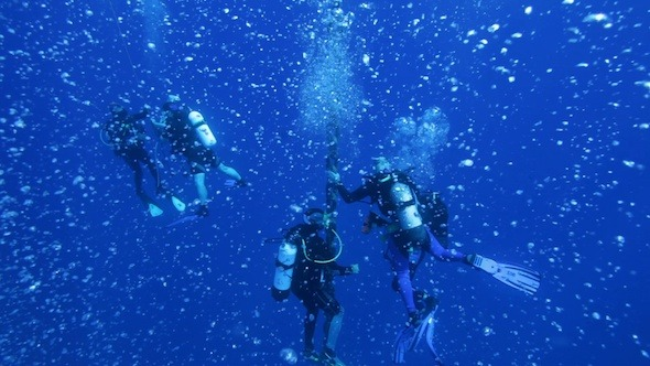 Group Of Divers With Many Air bubbles