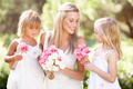 Bride With Bridesmaids Outdoors At Wedding - PhotoDune Item for Sale