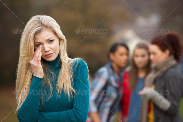 PhotoDune Upset Teenage Girl With Friends Gossiping In Background 329136