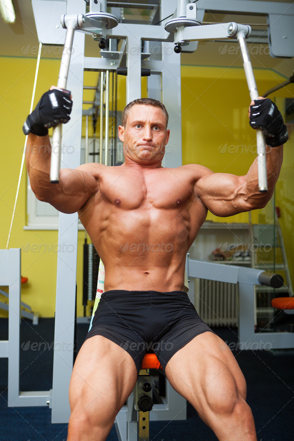 Muscle shaped man exercise on sport gym - Stock Photo - Images