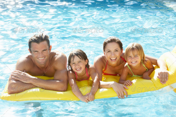 PhotoDune Young family parents with children in pool 330802