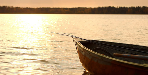 Fishing Wooden Boat With Rods At Sunset