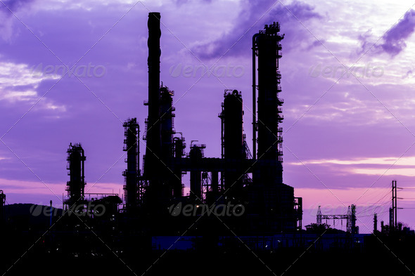 silhouette of oil refinery plant at twilight morning - Stock Photo - Images