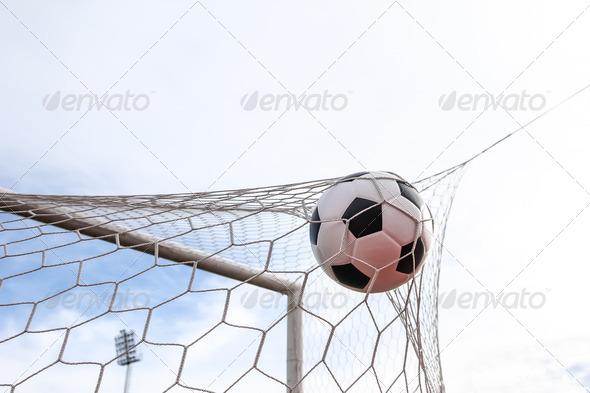 soccer ball in goal net - Stock Photo - Images
