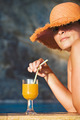 Attractive woman in hat with glass of orange juice - PhotoDune Item for Sale