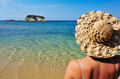 Young woman in hat looking at small island - PhotoDune Item for Sale