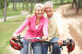 Senior couple riding bicycle in park - PhotoDune Item for Sale