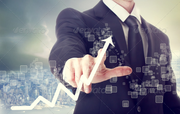 Businessman Touching a Chart Indicating Growth - Stock Photo - Images