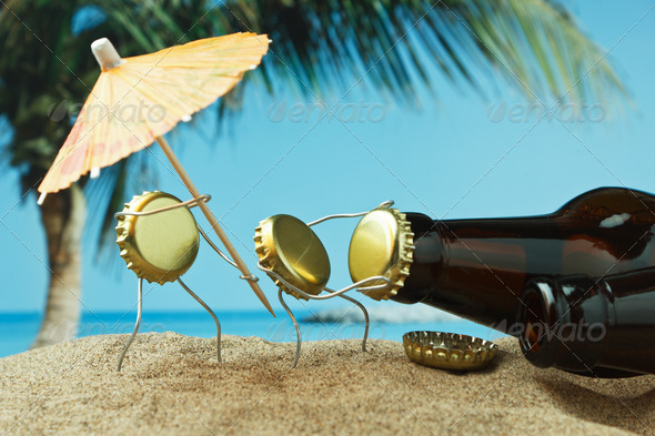 funny bottle cork on a sandy beach - Stock Photo - Images