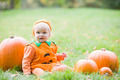 Baby boy outdoors in pumpkin costume with real pumpkins - PhotoDune Item for Sale
