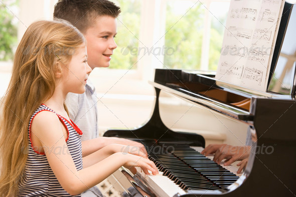 Stock Photo - PhotoDune Brother And Sister Playing Piano 332496