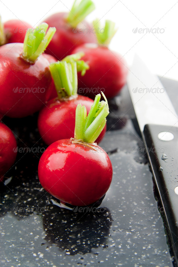 Chopping radishes - Stock Photo - Images