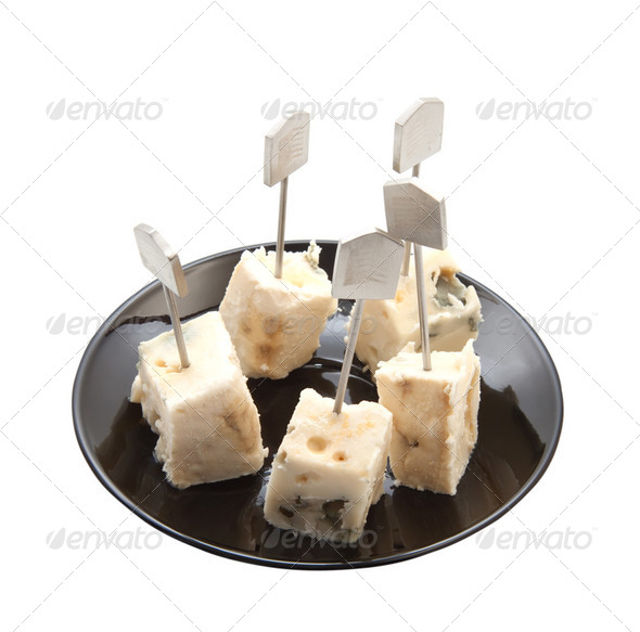Roquefort cheese portions on a platter - Stock Photo - Images