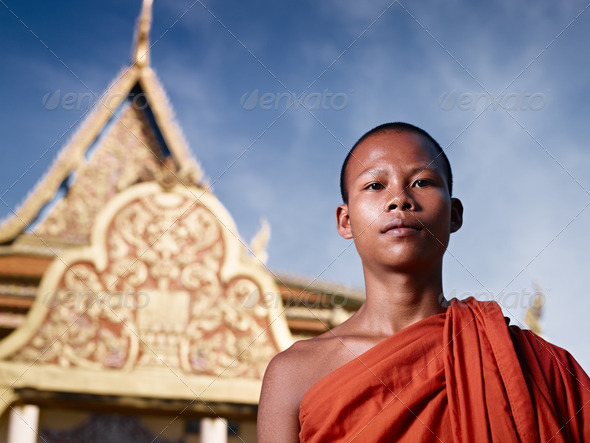 Portrait of buddhist monk near temple, Cambodia, Asia - Stock Photo - Images