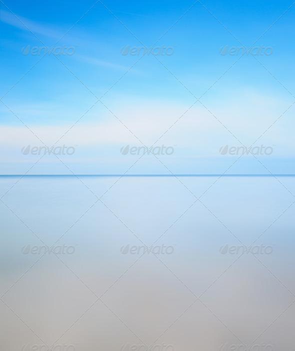 Long exposure photography. Horizon line, soft sea and blue sky