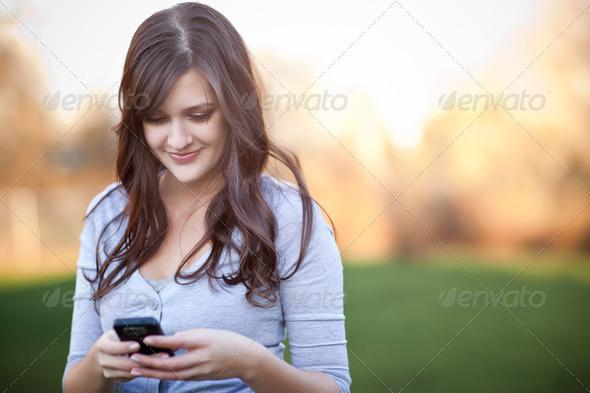 PhotoDune Woman texting 2043741