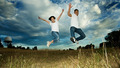 Asian couple jumping in joy