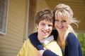 Caucasian couple in front of house