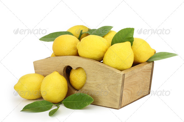 Wooden box full of lemons - Stock Photo - Images