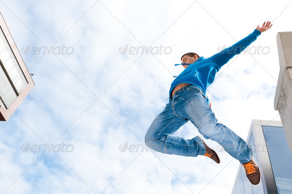 Jumping young man - Stock Photo - Images