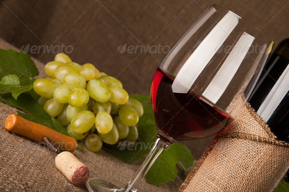 Still life with wine bottles, glasses and grapes - Stock Photo - Images