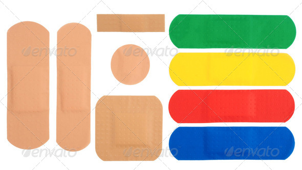Sticking plasters isolated on white background - Stock Photo - Images
