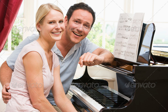 Stock Photo - PhotoDune Couple sitting at piano smiling 337577
