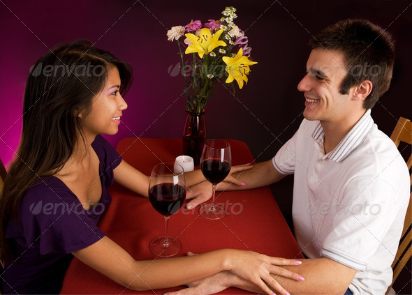 Couple Getting Closer While Having Wine - Stock Photo - Images