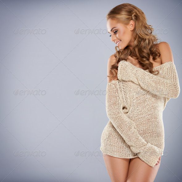 Pretty blonde girl posing while isolated - Stock Photo - Images