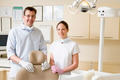 Dentist and assistant in exam room smiling - PhotoDune Item for Sale