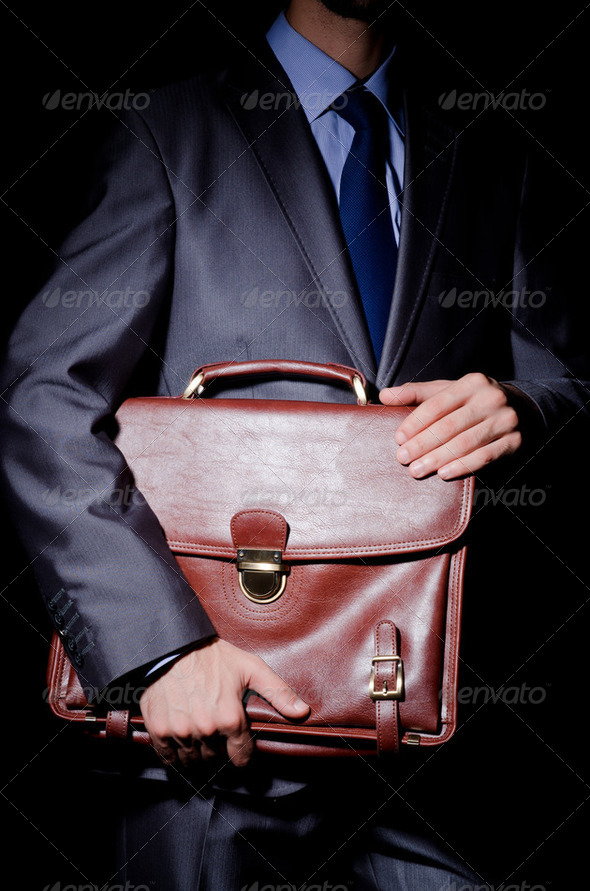 Business spy with briefcase - Stock Photo - Images
