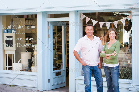 PhotoDune Couple standing in front of organic food store smiling 339430