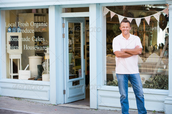 PhotoDune Man standing in front of organic food store smiling 339432