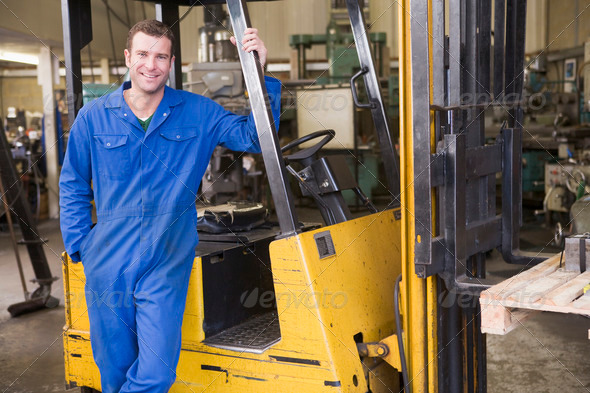 Stock Photo - PhotoDune Warehouse worker standing by forklift 339496