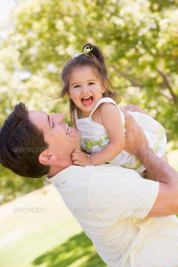 Stock Photo - PhotoDune Father holding daughter outdoors smiling 339683