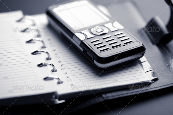 organizer and mobile phone - Stock Photo - Images