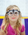 blond children girl with optometrist diopter glasses - PhotoDune Item for Sale