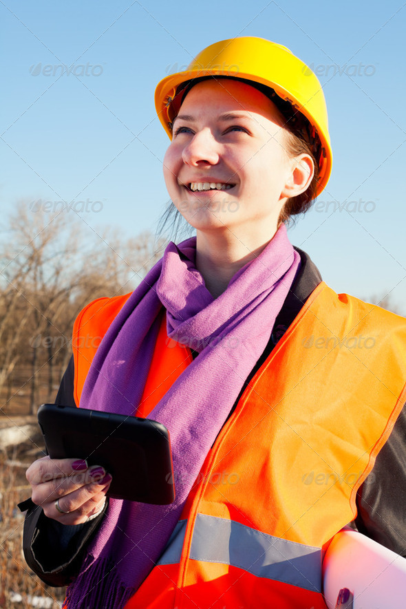 Young lady architect staying outdoors - Stock Photo - Images