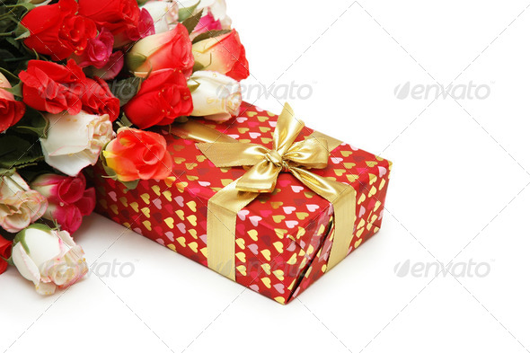 Gift box and bunch of flowers isolated on white - Stock Photo - Images