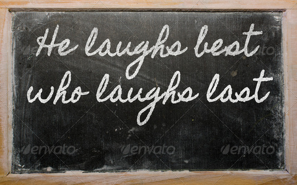 expression -  He laughs best who laughs last - written on a scho - Stock Photo - Images