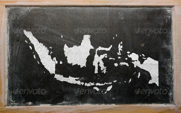 outline map of indonesia on blackboard - Stock Photo - Images