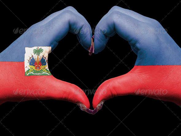 Heart and love gesture by hands colored in haiti flag for touris - Stock Photo - Images