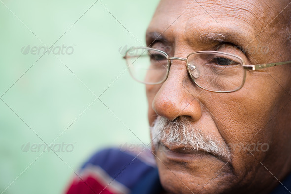 Worried senior african american man with eyeglasses - Stock Photo - Images