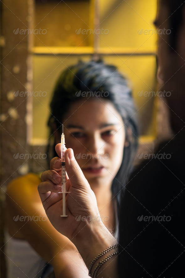 Drugs and people, man helping woman with heroin syringe - Stock Photo - Images