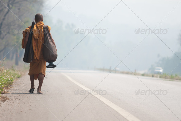 Buddhist monk take to the road in forest as a form of meritamaki - Stock Photo - Images