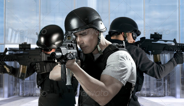 PhotoDune Police against terrorism two soldiers at a business building 2137781