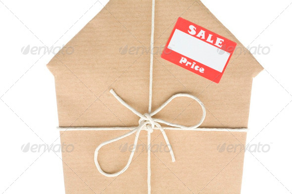 House Wrapped In Brown Paper With Sale Sticker - Stock Photo - Images