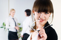 Pretty business woman in office at collegues background - PhotoDune Item for Sale