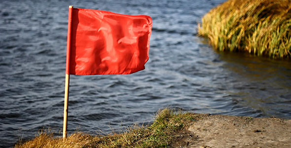 Red Flag On Wind And Lake