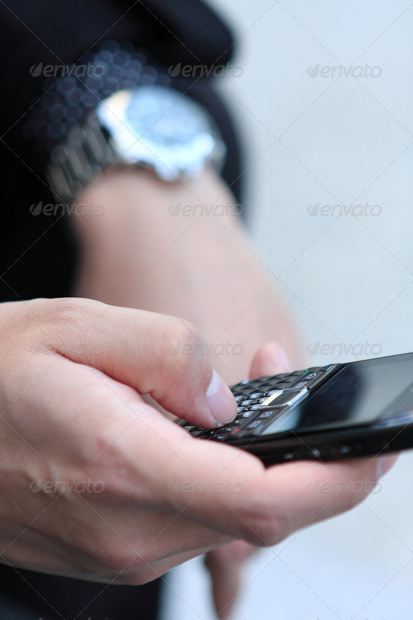 Mobile phone in man hand - Stock Photo - Images